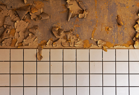 dilapidated wall: Old cracked dilapidated wall and ceramic tiles Stock Photo