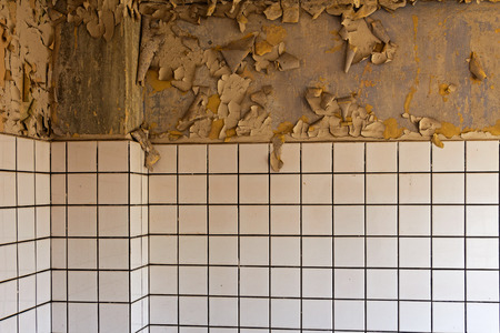 Old cracked dilapidated wall and ceramic tile photo