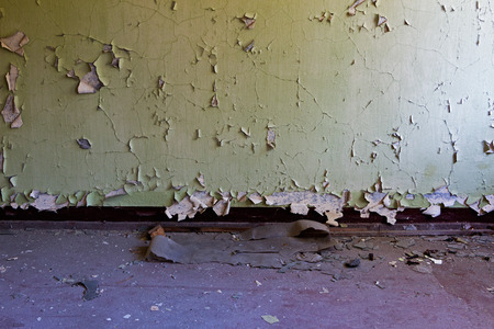 decrepit: Old wall and floor in a deserted room