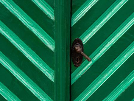 doorhandle: The old wooden door in turquoise color Stock Photo