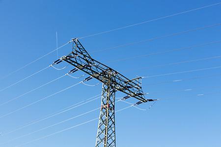 electricity pylon: Electricity pylon against the blue sky