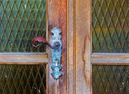 doorhandle: Iron door handle on an old wooden door Stock Photo