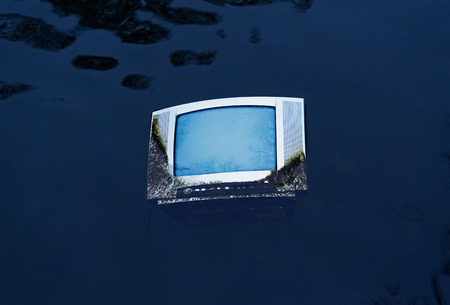televisor: Old TV in the water of the pond Stock Photo