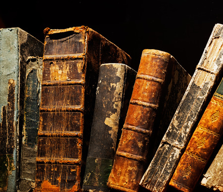 brown paper: Old and ancient books on a shelf Stock Photo
