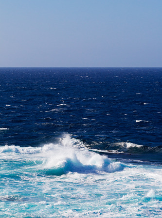 ocean waves: Ocean waves and surf in the sunlight Stock Photo