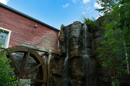 watermill: Watermill and waterfall at stone walls of a house in Germany