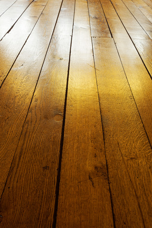 burnished: Old painted wooden floor in the backlight