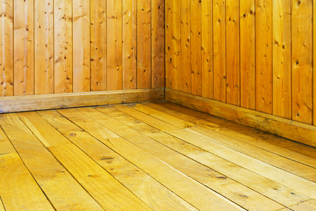 burnished: Old varnished wooden floor and wall of a room
