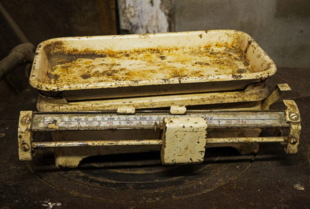 weigher: Old rusty scales in a rustic barn Stock Photo