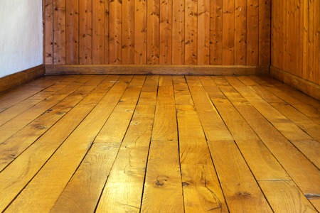 Old Varnished Wooden Floor And Wall Of A Room Stock Photo Picture