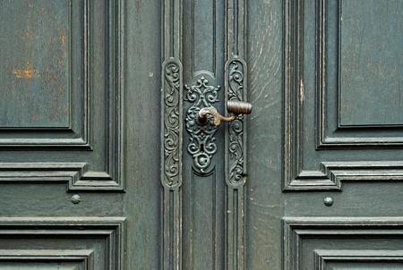 doorhandle: The fragment of black and old, wooden door