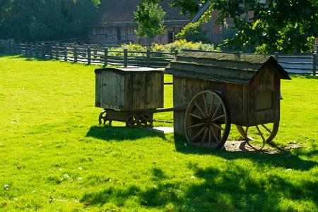 farmyard: Decorative house on wheels  on the farmyard in the sunlight
