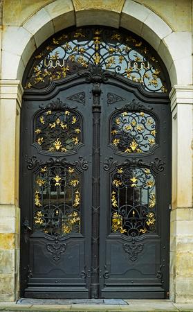 doorhandle: The black and old, iron door