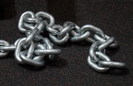 strength training: Heavy metal chain for strength training on the floor Stock Photo