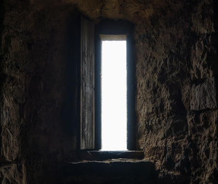 ancient prison: Dark room with stone walls and window