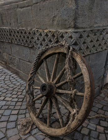 mediaeval: Old and vintage cartwheel on the corner of building
