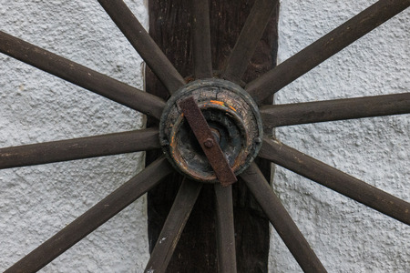 farmhouse: The old  wheel on wall of  farmhouse