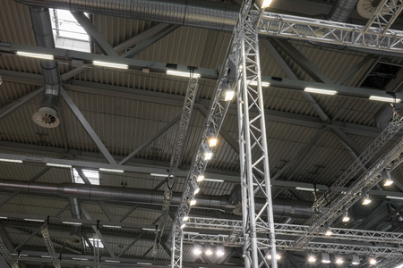 roof framework: Ceiling of the room with a metal construction and ventilation