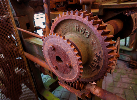 pinion: Old and rusty pinion gear of a machine in factory