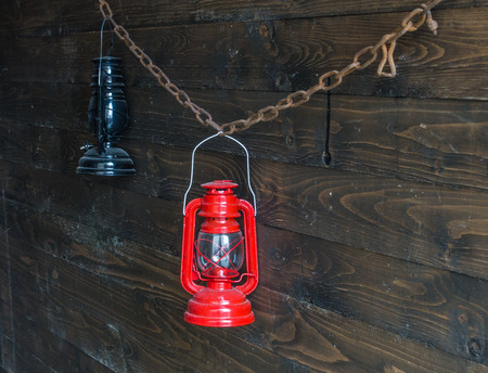 red oil lamp: Two old oil lamp on a wooden wall