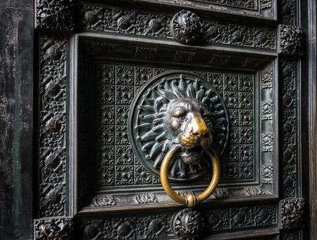 garniture: Old door with lion door knocker of  Cologne Cathedral