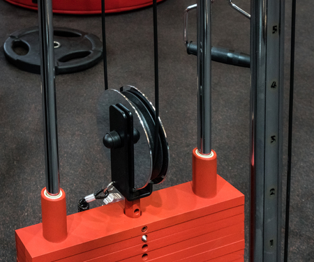 training wheels: weight machine with cable and plate weight in fitness center
