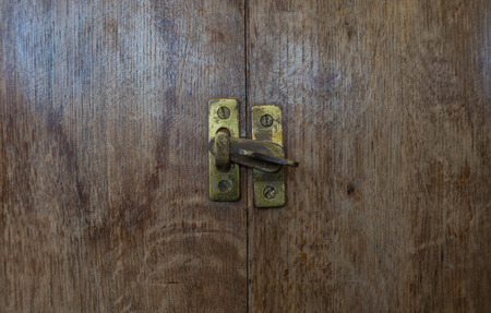 pawl: Wooden shutters on the barrels with the latch Stock Photo