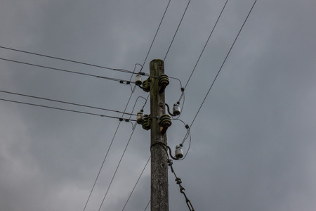 sulight: The electricity wooden pylon against a sky. Stock Photo