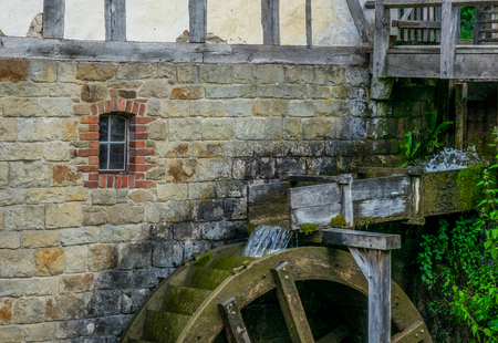 The old water mill on creek in village.