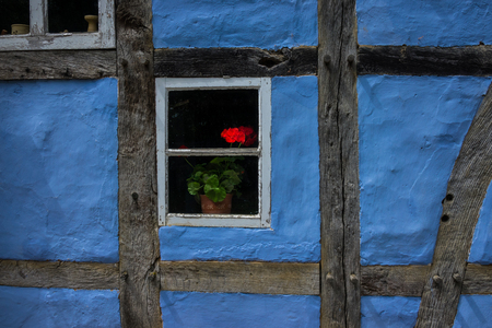 half timbered: The flowers in window of an old farmhouse.