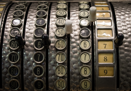 teclado numerico: The fragment of old and vintage adding machine. Foto de archivo