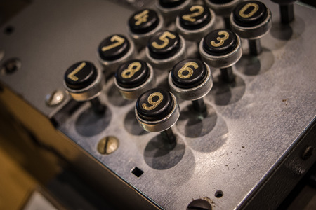 adding: The old and vintage keyboard of a control panel.