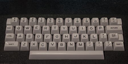 The old and vintage keyboard of a control panel.