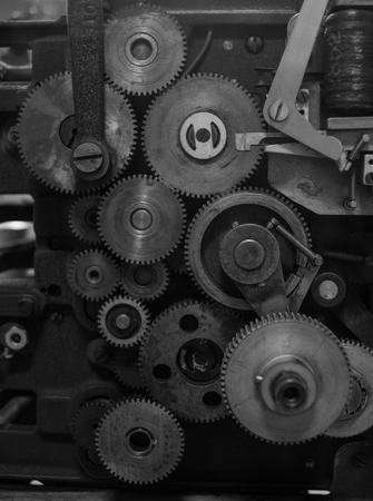 The gears of a old and vintage machine.