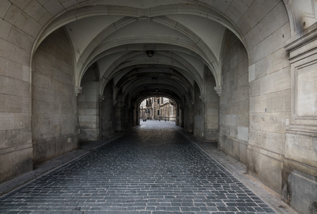 inwardly: Dark stone street  in an old town Dresden. Stock Photo