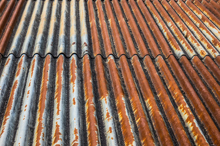 The old and rusty iron roof of a building.