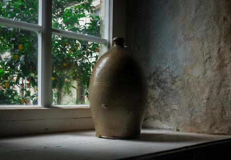 chatty: The old crock on windowsill  in farmhouse. Stock Photo