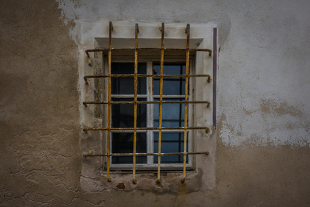 lattice window: The window with lattice in wall of an old building.