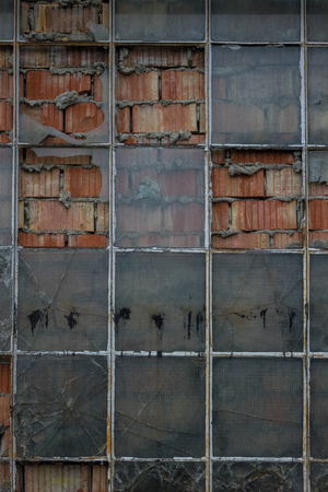 The old brick wall with glass of window. Stock Photo