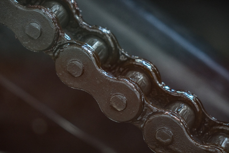 The old and vintage chain belt of a engine. Stock Photo