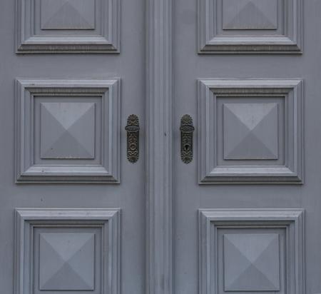 door handle: The old vintage door with handle and keyhole .