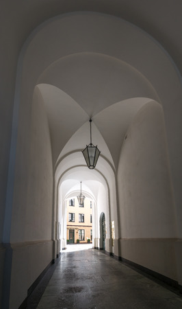 The archway of a building in city Munich, Germany .