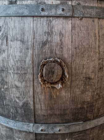 The old and wooden barrel with cork . Фото со стока