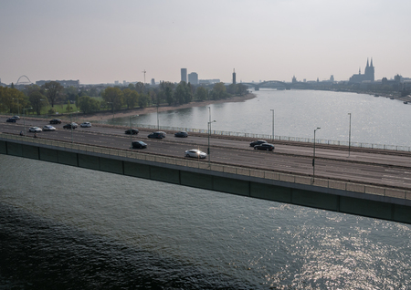 The bridge over river Rhine in city of Cologne .