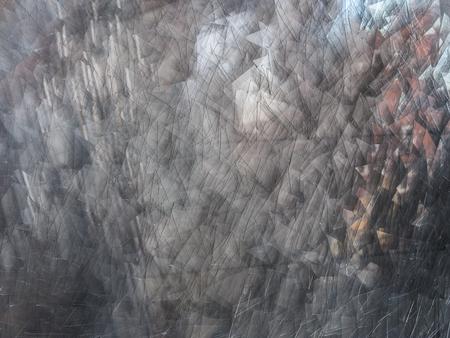 Background of broken glass fragments, macro .