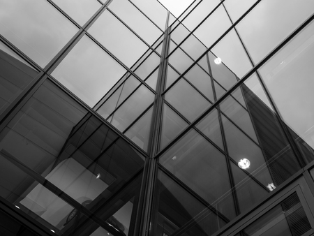 The glass architecture in city against a sky . Imagens