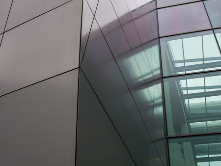 The glass architecture in city against a sky . Banco de Imagens