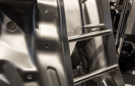 Metal parts of a car in automotive production .