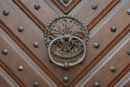 The old and ancient door with door knocker . Stok Fotoğraf