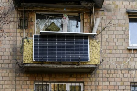 The solar battery panel mounted on the balcony of an apartment building in Kyiv, Ukraine. Banque d'images
